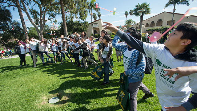 Fifth-grade students on a visit to campus launch airplanes during a STEM activity, part of the TRANSFERmation outreach to schools in the Pomona Unified School District.
