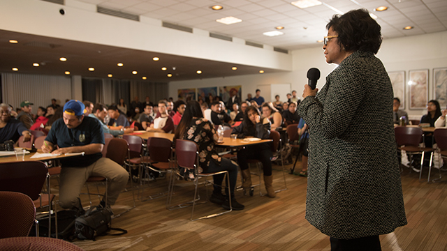 President Soraya Coley answers questions during Pizza with the Presidents.