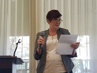 Cal Poly Pomona alumna Carol Zitzer-Comfort speaks to students at the annual Reading, Advising, & Mentoring Program graduate recognition luncheon.