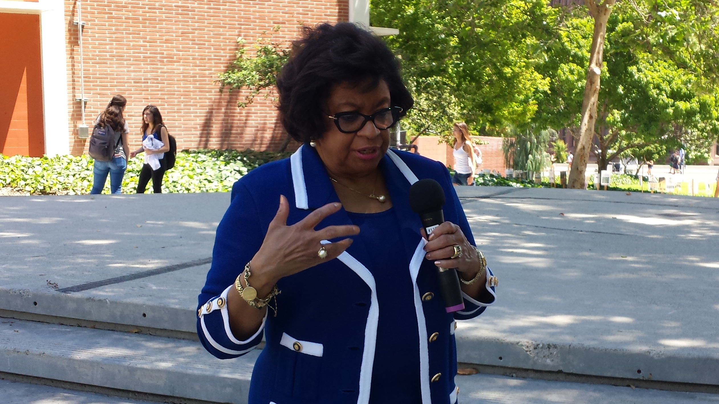 President Soraya M. Coley answers a question at Pizza With the Presidents on May 2.