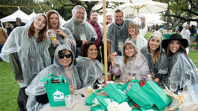Revelers donning ponchos refuse to let the weather spoil their fun at Cal Poly Pomona Tasting & Auction.