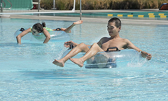 Jimmy Hu and Marina Deleon keep cool in the BRIC pool at Cal Poly Pomona.