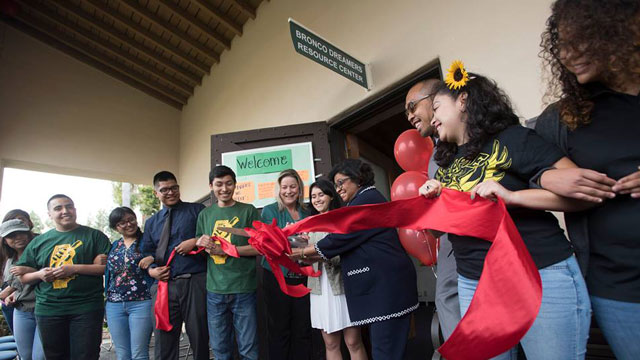 University President Soraya M. Coley cuts the ribbon on the Bronco Dreamers Resource Center at a preview event May 25.