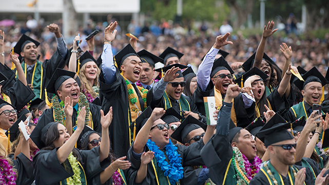 Cal Poly Pomona graduates celebrate during commencement.