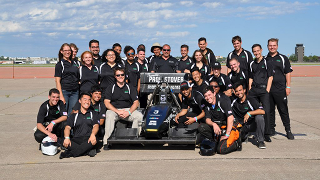 Professor Cliff Stover with the Cal Poly Pomona Formula One team and car.