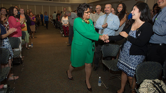 President Soraya Coley greets staff members during the 2016 Fall Conference.