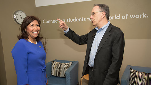 Congresswoman Norma Torres, with Career Center Director Tom Munnerlyn, checks out the center's waiting room area.