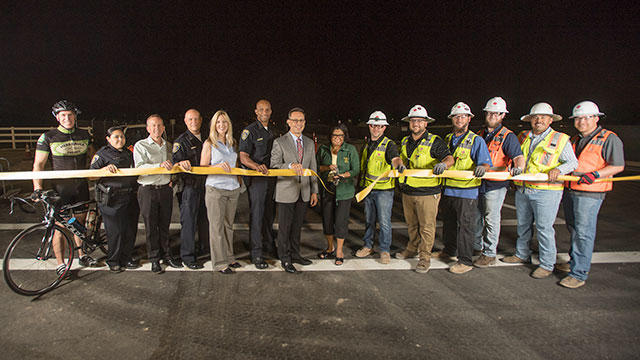 University administrators, campus police and members of Sundt Construction join President Soraya M. Coley at ribbon-cutting ceremony.