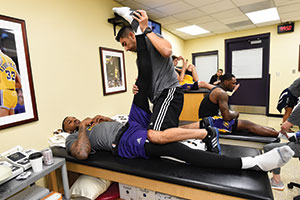 Nuñez treats Lakers center Tarik Black before a game against the Houston Rockets in October 2016.