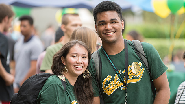 Two Cal Poly Pomona freshman students pose during CPPFest.
