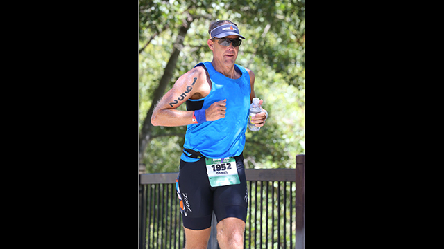 Daniel E. Montplaisir, vice president for the Division of University Advancement running the IRONMAN.