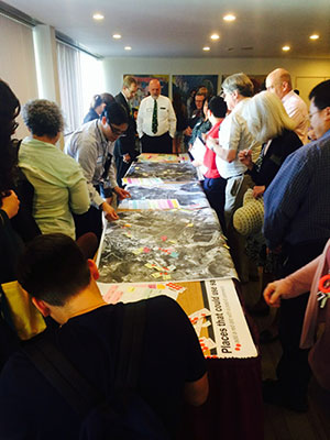 Attendees at a campus master plan workshop mark areas of Cal Poly Pomona that they like and dislike on large maps.