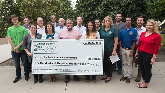 Dean Lisa Kessler accepts the Orange County Farm Bureau's donation of $165,000 to the Don B. Huntley of Agriculture.