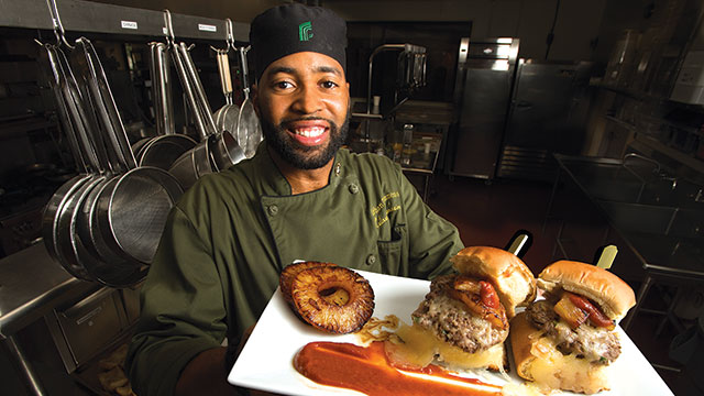 "Lathan Simmons presents bison sliders, one of the creations that earned him the nickname ""Sauce Boss"" at The Collins College of Hospitality Management."