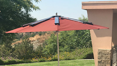 Solar powered charging umbrella installed at collins polycentric - Zon parasol ...