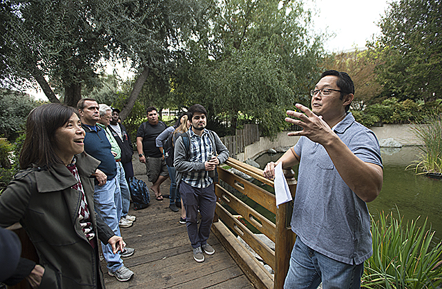 Landscape architect Keiji Uesugi leads a tour of the Aratani Japanese Garden, which was designed by his father, Takeo Uesugi. He explained the thought process in the design.