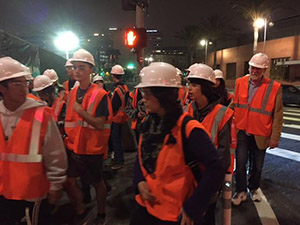Students don orange vests and hard hats on their midnight visit to the Downtown Regional Connector project site during Noir LA 2016.