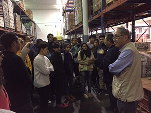 Dean Michael Woo, far right, and the Noir LA 2016 group at Times Produce's warehouse at the downtown LA's Produce District.