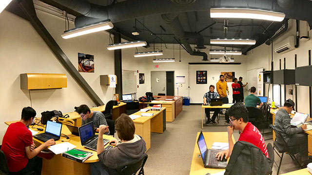 Students working after hours at the Liquid Rocket Lab.