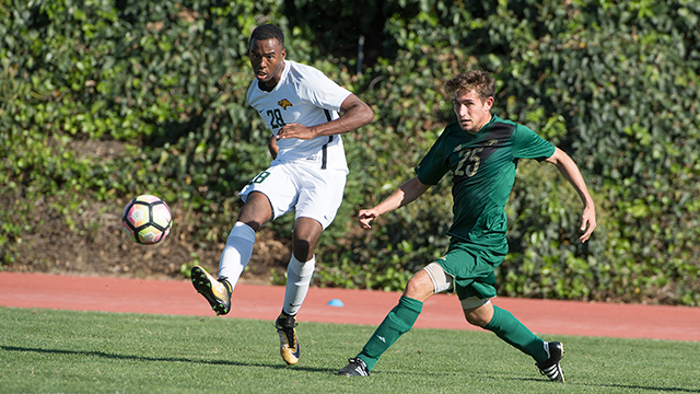 Cal Poly Pomona soccer player kicks the ball