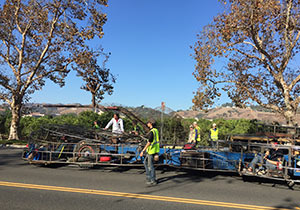 The Rose float with the wire cage travels on South Campus Drive during the mechanical inspection.