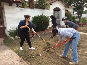 Cal Poly Pomona students do yard work at Urban Mission in Pomona.