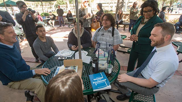 President Soraya Coley talks with students and faculty at CLASS during Pizza with the Presidents College tour.