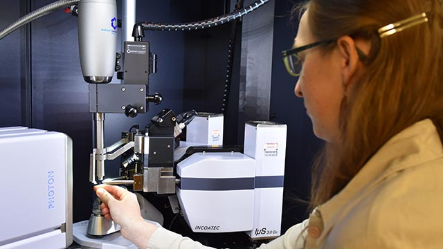 Chemistry Professor Chantal Stieber loads a sample into Cal Poly Pomona's new Single Crystal X-Ray Diffractometer, which is already being used by undergraduate students.
