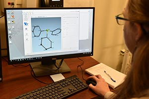 2)Chemistry Professor Chantal Stieber looks at sample results from Cal Poly Pomona's new Single Crystal X-Ray Defractometer, a top of the line machine purchased with a Department of Defense grant.