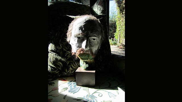 """Peter Yates, chair of the music department, makes art that encompasses music composition, puppetry, performance art, pop art and so much more, including the mask of his face pictured. His most recent project is titled """"A Song A Week A Year,"""" which will feature the release of an original music video online at each phase of the moon."""