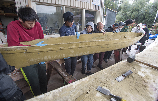 The concrete canoe team removes their canoe from its mold for the first time at Cal Poly Pomona.