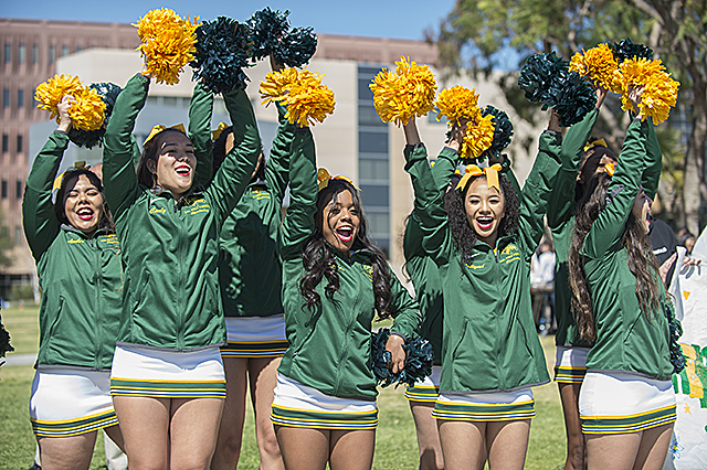 Cheerleaders give a yell during Pep Rally in University Park as part of Spirit Week at Cal Poly Pomona.