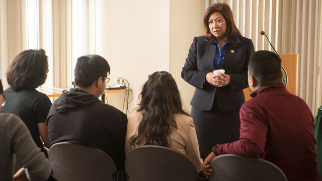 Congresswoman Norma Torres talks to students before a forum on DACA.