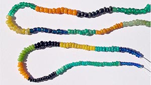 Top string: Zimbabwe series beads. Bottom String: Mapungubwe Oblate series beads.