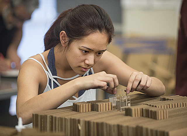 Anne Jao works on her model in her Architecture 103 class in the Interim Design Center at Cal Poly Pomona.