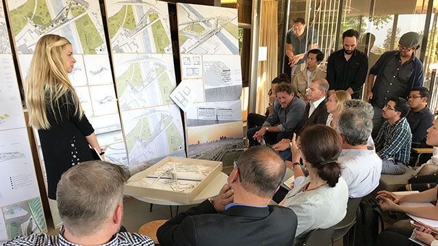 "Brie Jones, '17 master's degree in architecture (sustainability track), presents her thesis ""Prescriptive Hydrologies"" to practicing architects from well-known firms and architecture in June of 2017."