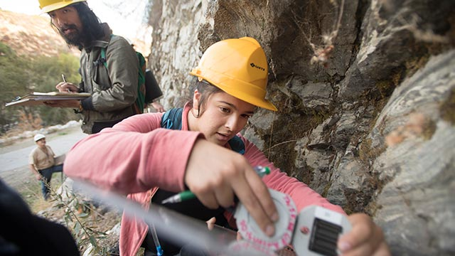 A senior Geology major, take measurements during her Structural Geology class during a field trip to the West Fork of San Gabriel Canyon.