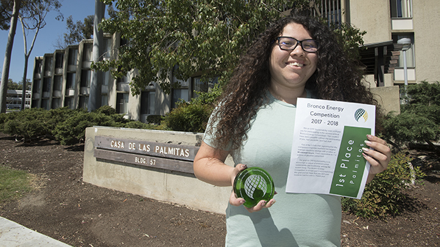 "Kimberly Ramirez, one of the residential advisors at Palmitas Residence Hall, cited a ""team effort"" in winning the Bronco Energy Trophy for power conservation."
