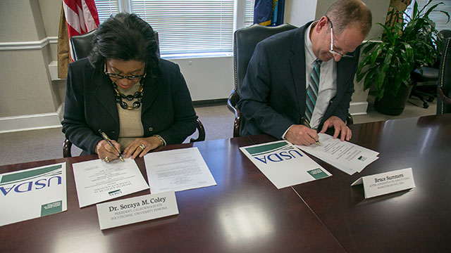 President Soraya M. Coley and U.S. Department of Agriculture's (USDA) Agricultural Marketing Service (AMS) Acting Administrator Bruce Summers sign the cooperative agreement at USDA Headquarters in Washington, D.C., in April.