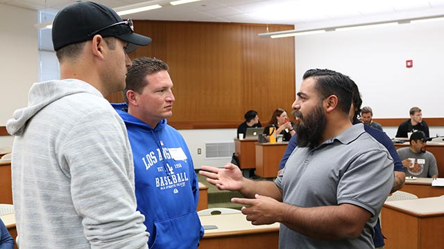 Senior Sergio Flores (left), who is majoring in civil engineering, speaks with two veterans who have been provisionally admitted to Cal Poly Pomona.