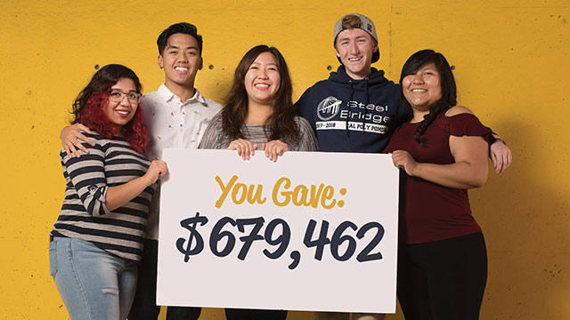"Cal POly Pomona students holding up a sign that says ""You Gave $679,462.""9"