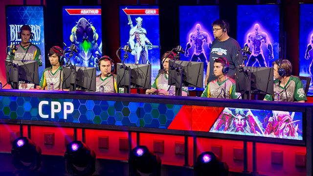 The Cal Poly Pomona Ponies Heroes of the Dorm esports team discuss strategy while making their team picks before the national semifinal match begins.
