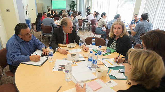 Faculty and Staff in a round table session during the WSCUC Town Hall.