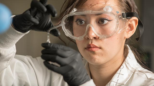 Chemical Engineering junior Brooke Singleton with a sample as she does research.