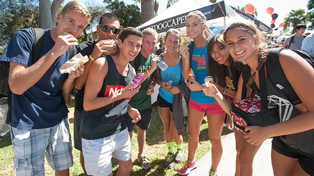 Students eat hot dogs at the Hot Dog Caper.