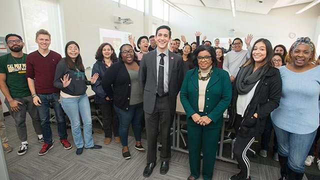 President Soraya M. Coley and students from the Collins College during Pizza with the Presidents.
