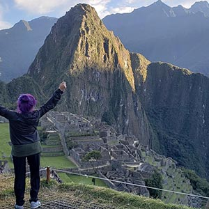 Marisol celebrates at the top of Machu Pichu.