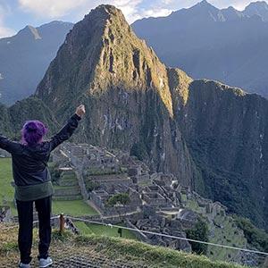Marisol celebrates at the top of Machu Pichu.