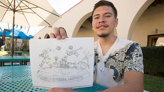 Carlos Aceytuno, a second year Graphic Design major, with his original sketch that will become the 2019 Cal Poly Universities Rose Float.
