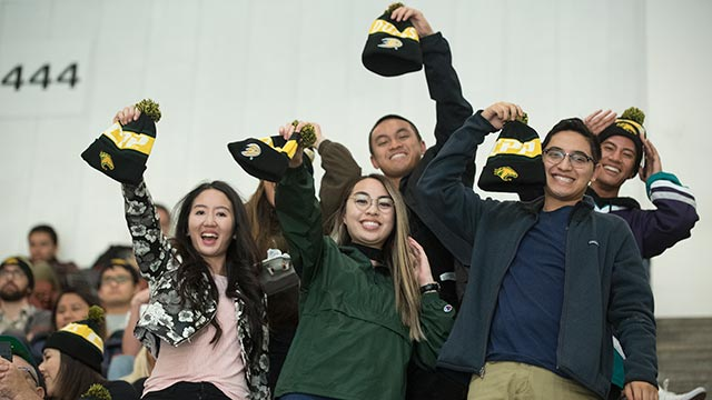 CPP Students enjoying their free CPP beanies at the Ducks game.
